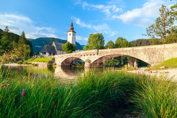 Church of Sv. John the Baptist and a bridge by the Bohinj lake Stock photo © Fesus