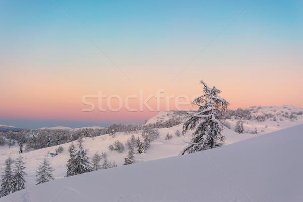 Puesta de sol invierno alpes montanas cielo Foto stock © Fesus
