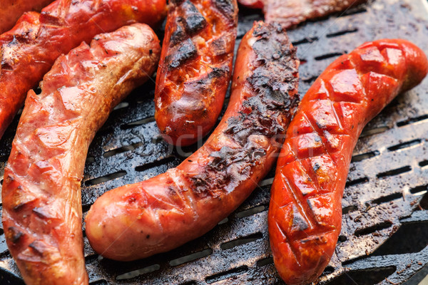 Grilling sausages on barbecue grill Stock photo © Fesus