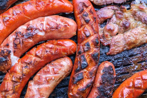 Grillowanie kiełbasy grill selektywne focus ognia obiedzie Zdjęcia stock © Fesus
