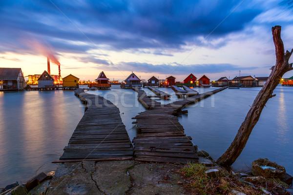 Zonsondergang meer pier vissen houten Stockfoto © Fesus