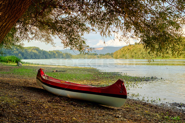 Red canoe on beach at river Danube Stock photo © Fesus