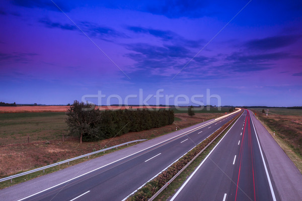 Cars speeding on a highway Stock photo © Fesus
