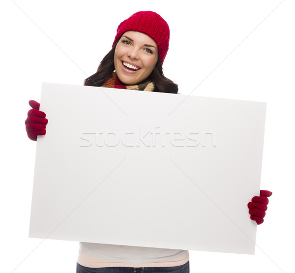 Excited Girl Wearing Winter Hat and Gloves Holds Blank Sign  Stock photo © feverpitch