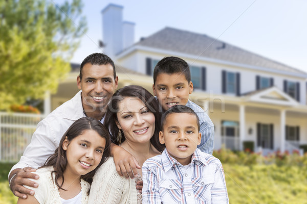 Hispanic Family in Front of Beautiful House Stock photo © feverpitch