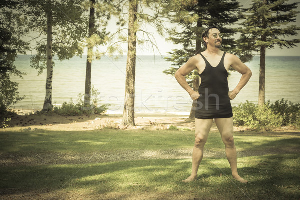 Gentleman Dressed in 1920's Era Swimsuit on Lake Shore Line Stock photo © feverpitch