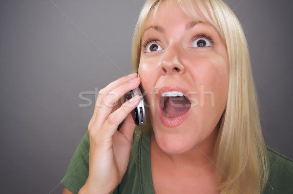 Stunned Blond Woman Using Cell Phone  Stock photo © feverpitch