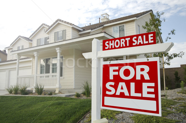 Short Sale Home For Sale Sign and House - Right Stock photo © feverpitch