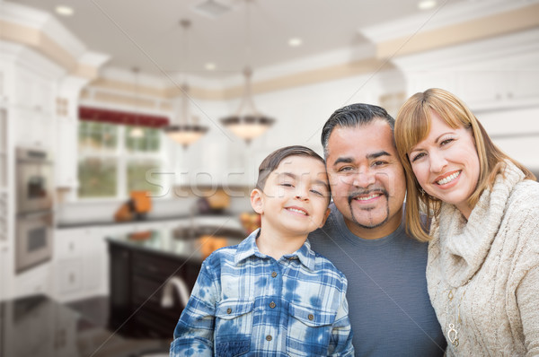 Young Mixed Race Family Having in Beautiful Custom Kitchen Stock photo © feverpitch