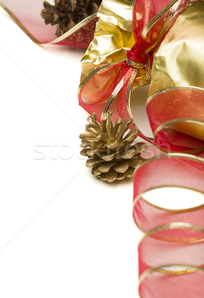 Stock photo: Christmas Present with Red Ribbon and Pine Cones on White
