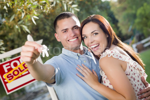 Military Couple with House Keys and Sold Real Estate Sign Stock photo © feverpitch