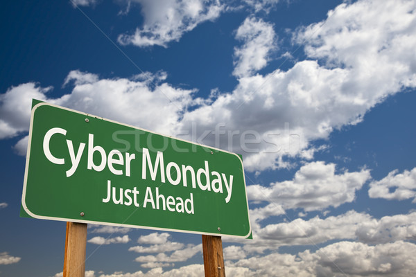 Cyber Monday Just Ahead Green Road Sign and Clouds Stock photo © feverpitch