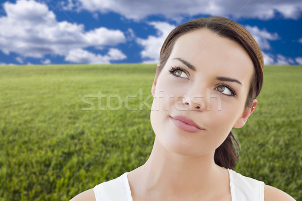 Contemplative Woman in Grass Field Looking Up and Over Stock photo © feverpitch