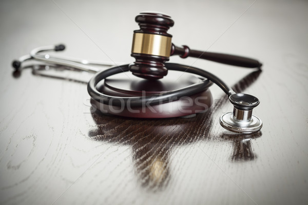 Gavel and Stethoscope on Reflective Table Stock photo © feverpitch