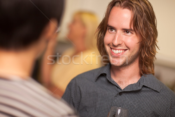 Smiling Young Man with Glass of Wine Socializing Stock photo © feverpitch