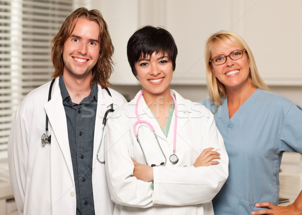 Three Smiling Male and Female Doctors or Nurses Stock photo © feverpitch