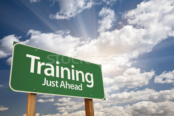 Training Green Road Sign Over Clouds Stock photo © feverpitch