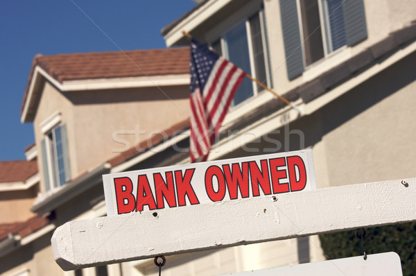 Stock photo: Bank Owned Real Estate Sign and House with American Flag