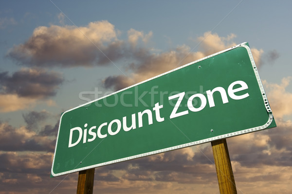 Discount Zone Green Road Sign and Clouds Stock photo © feverpitch