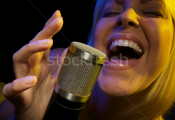 Woman Sings with Passion Stock photo © feverpitch