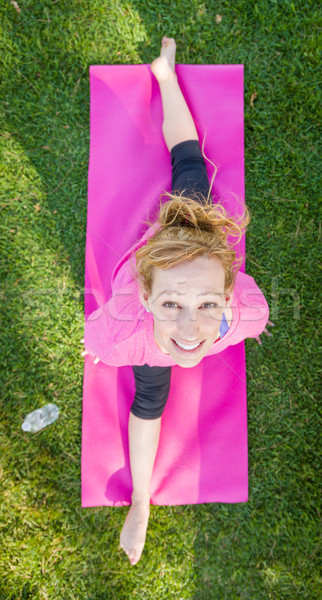 Overhead of Young Fit Flexible Adult Woman Outdoors on The Grass Stock photo © feverpitch