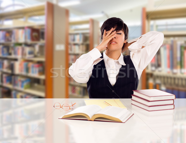 Young Female Mixed Race Student Stressed and Frustrated In Libra Stock photo © feverpitch