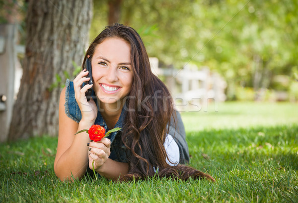 Stock photo: Attractive Happy Mixed Race Young Female Talking on Cell Phone O