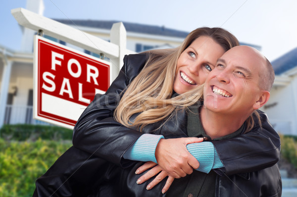 Happy Couple Hugging in Front of For Sale Real Estate Sign and H Stock photo © feverpitch