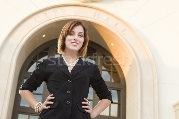 Young Pretty Businesswoman Outside in Front of City Hall Stock photo © feverpitch