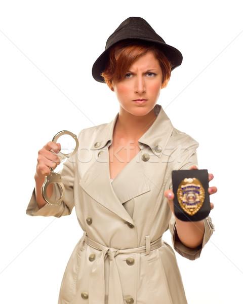 женщины детектив наручники Знак окоп пальто Сток-фото © feverpitch
