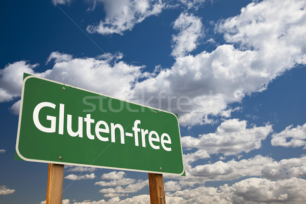 Gluten-free Green Road Sign and Clouds Stock photo © feverpitch