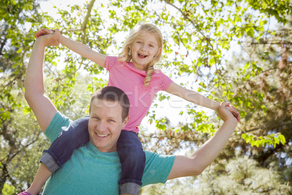 Cute Young Girl Rides Piggyback On Her Dads Shoulders Stock photo © feverpitch