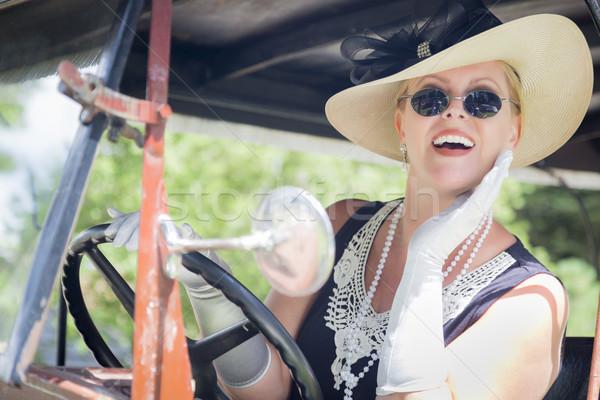 Aantrekkelijke vrouw twintiger rijden antieke aantrekkelijk jonge vrouw Stockfoto © feverpitch