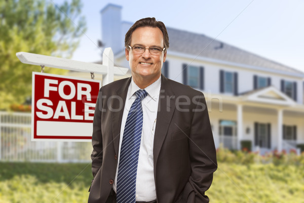 Agent immobilier vente signe maison Homme maison Photo stock © feverpitch