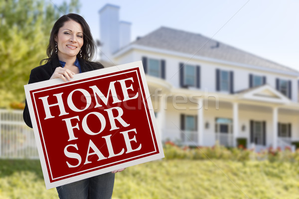 Woman Holding Home For Sale Sign in Front of House Stock photo © feverpitch