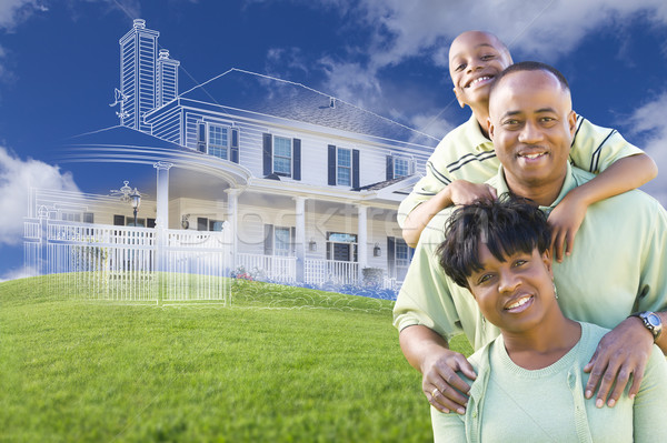African American Family with Ghosted House Drawing Behind Stock photo © feverpitch