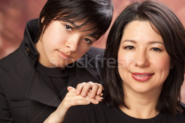 Attractive Multiethnic Mother and Daughters Portrait Stock photo © feverpitch