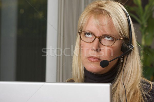 Attractive Businesswoman with Phone Headset Stock photo © feverpitch