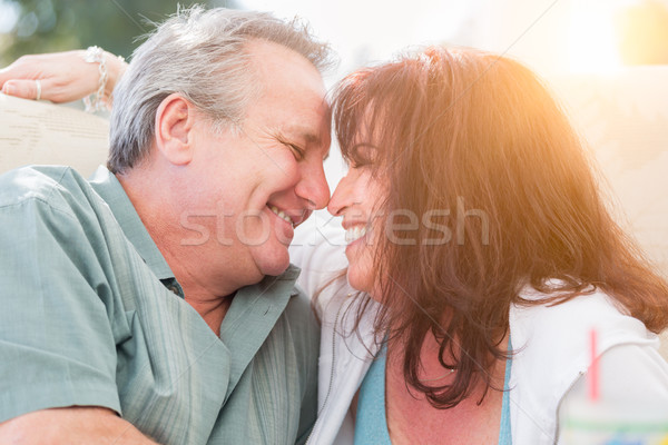 Happy Middle Aged Couple Enjoy A Romantic Moment Outside Stock photo © feverpitch