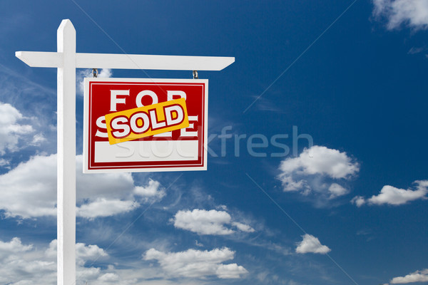 Right Facing Sold For Sale Real Estate Sign Over Blue Sky and Cl Stock photo © feverpitch