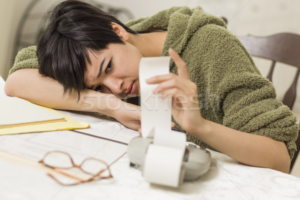Mixed Race Young Female Agonizing Over Financial Calculations Stock photo © feverpitch
