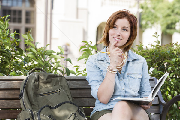 Stock photo: Young Female Student On Campus with Backpack on Bench
