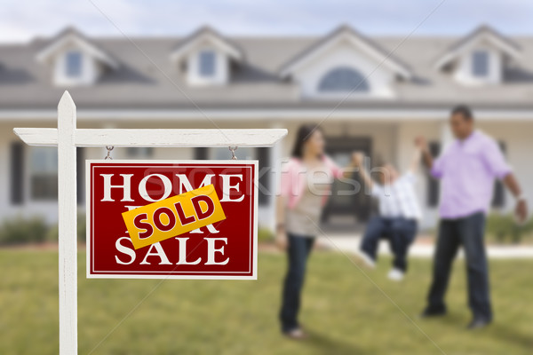 Stock photo: Sold Real Estate Sign and Hispanic Family in Front of House