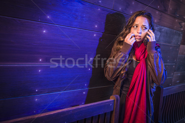 Frightened Young Woman in Dark Walkway Using Cell Phone Stock photo © feverpitch