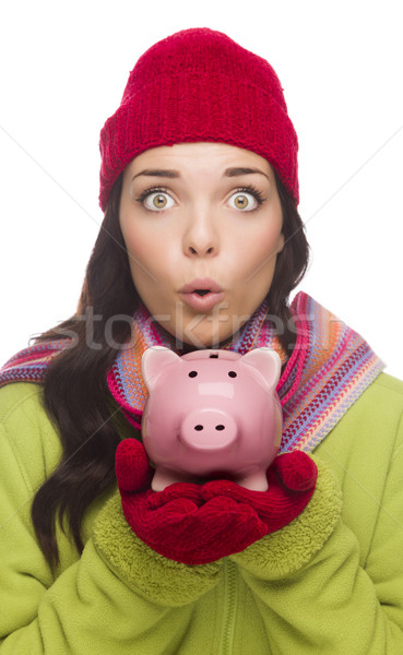 Expressive Mixed Race Woman Wearing Winter Hat Holding Piggybank Stock photo © feverpitch