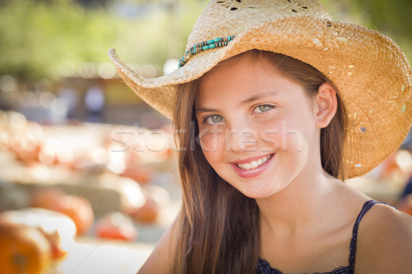 Preteen Girl Portrait Wearing Cowboy Hat at Pumpkin Patch Stock photo © feverpitch