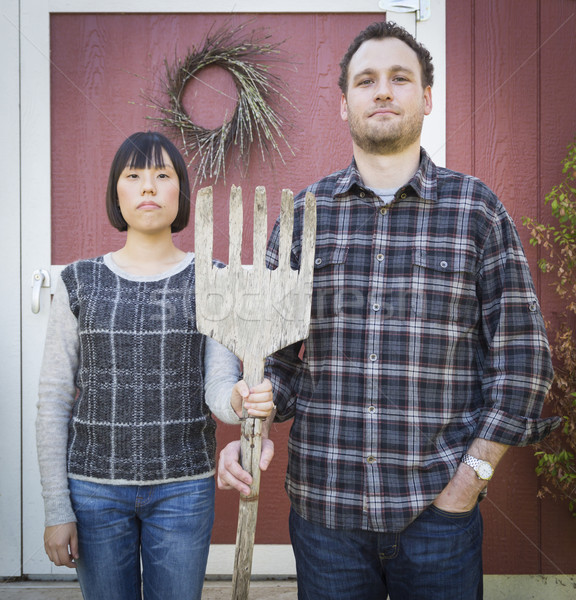 Fun Mixed Race Couple Portrait Simulating the American Gothic Pa Stock photo © feverpitch