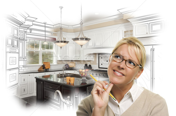 Woman With Pencil Over Custom Kitchen Design Drawing and Photo Stock photo © feverpitch