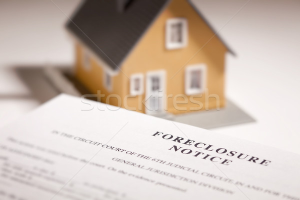 Foreclosure Notice and Model Home on Gradated Background Stock photo © feverpitch