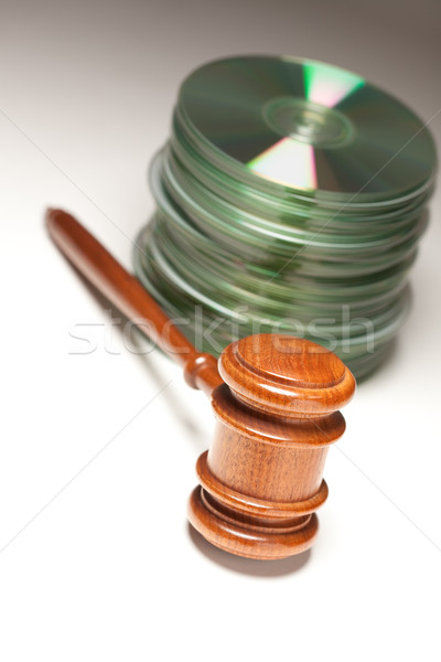 Stack of CD Rom or DVD Discs and Gavel Stock photo © feverpitch